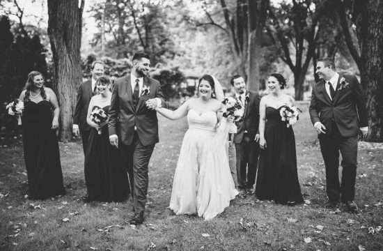 wedding party walking and laughing black and white