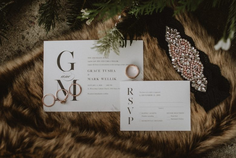 Flat lay of wedding details on fur coat
